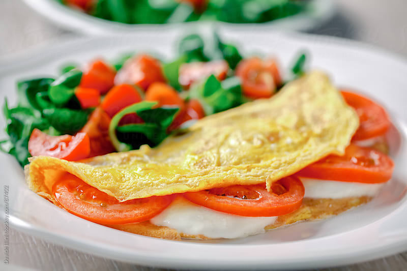 Omelette with Tomatoes and Mozzarella by Davide Illini for Stocksy United