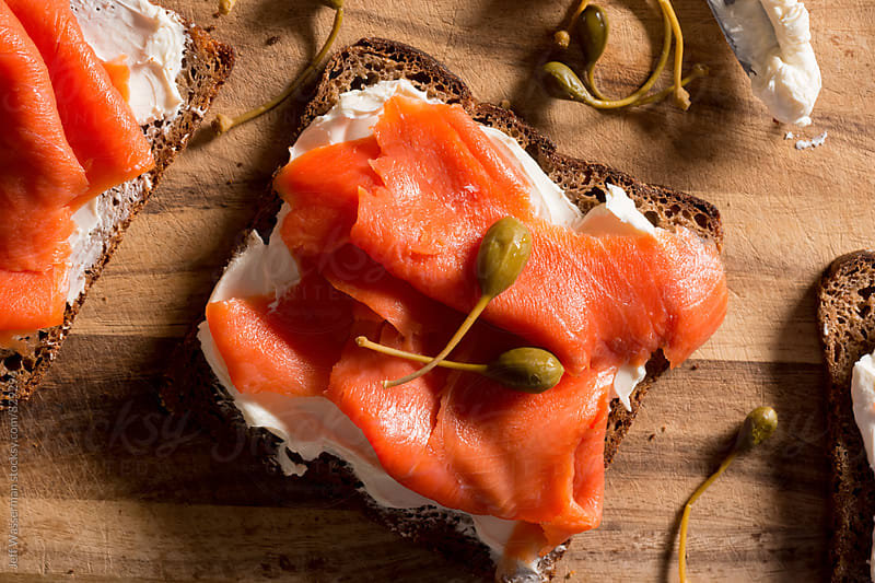 Smoked Salmon and Cream Cheese with Capers From Above by Jeff Wasserman for Stocksy United