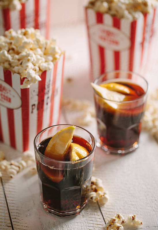Buckets full of popcorn with cola by Davide Illini for Stocksy United
