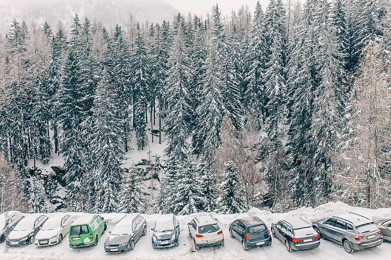Snow covered cars parked in the mountains in winter by Søren Egeberg Photography for Stocksy United