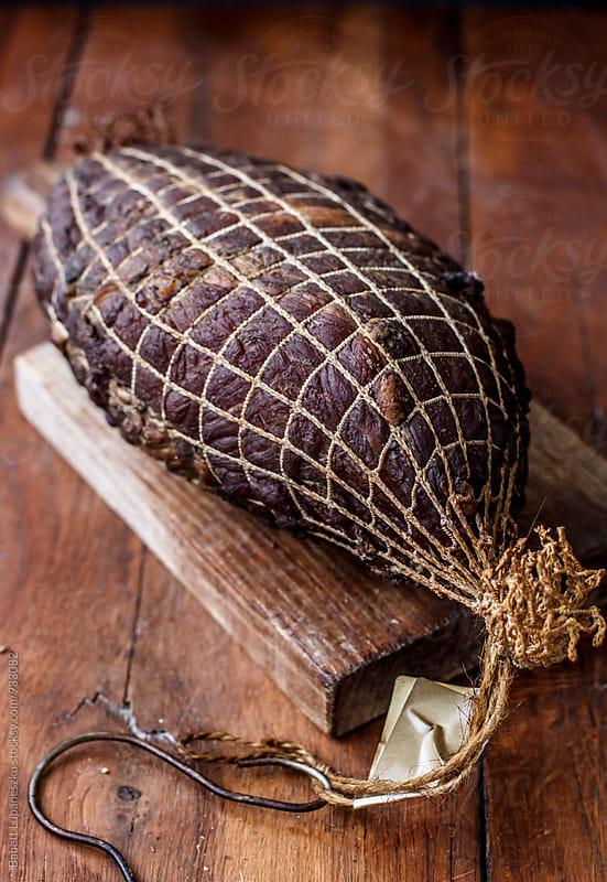 Smoked ham by Babett Lupaneszku for Stocksy United
