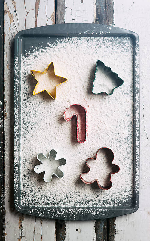 Holiday: Christmas Cookie Cutters In Flour by Sean Locke for Stocksy United