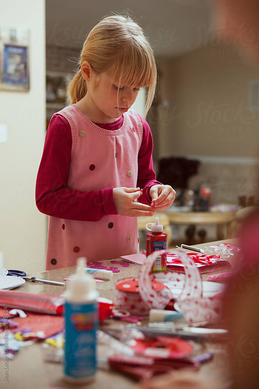 Valentine: Girls Working On Holiday Crafts by Sean Locke for Stocksy United