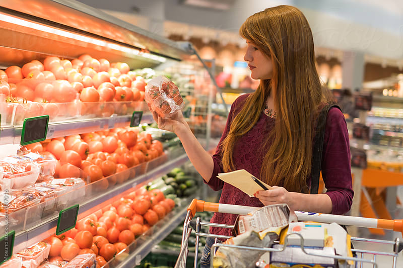 Woman Buying Fruits in a Supermarket by Mosuno for Stocksy United