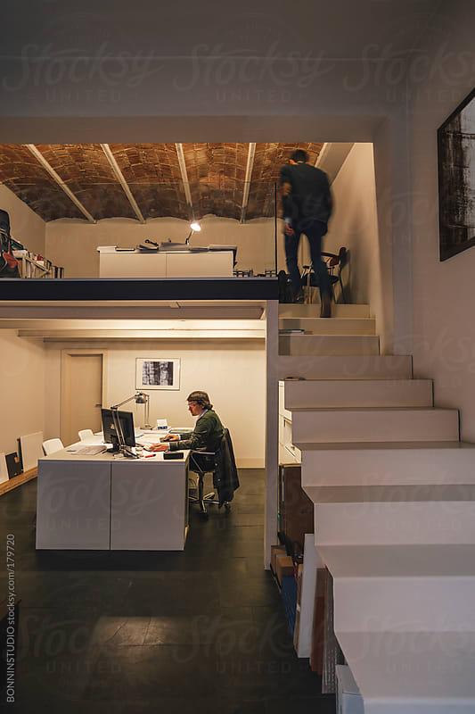 Interior designer men working on his creative workspace.  by BONNINSTUDIO for Stocksy United