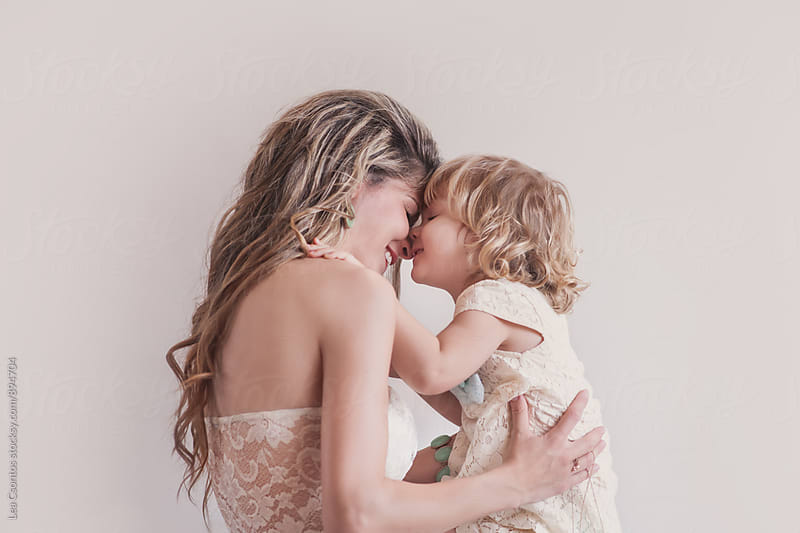 Beautiful mother and daughter snuggling and playing by Lea Csontos for Stocksy United