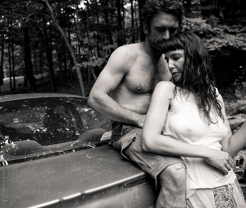 Hippie Couple in the Woods by Sari Wynne Ruff for Stocksy United