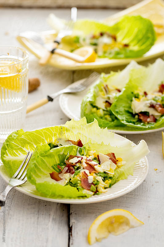 Shared Romaine Lettuce Salad with Egg and Bacon by Jeff Wasserman for Stocksy United