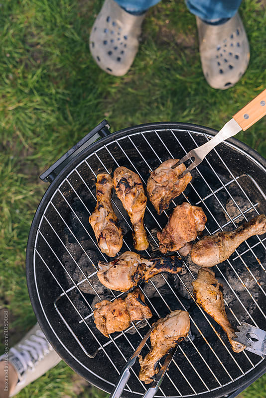 Chicken legs on the hot barbecue outdoor by RG&B Images for Stocksy United