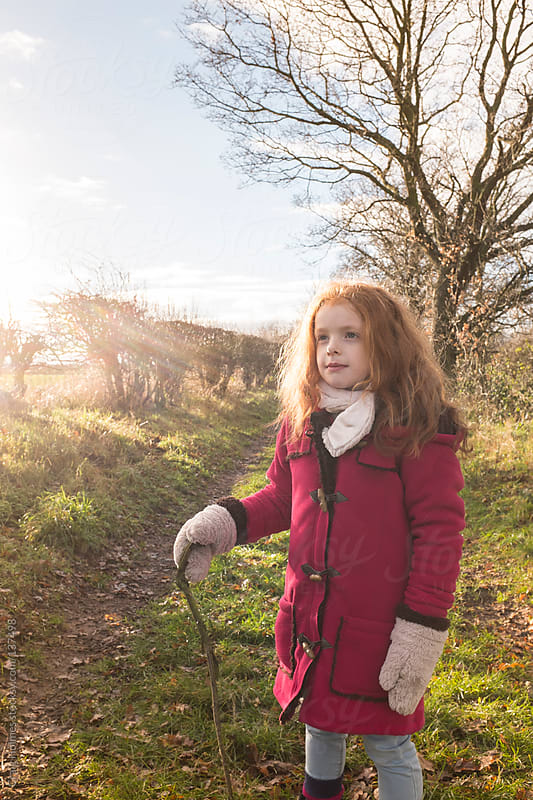 Child walking in the countryside by Craig Holmes for Stocksy United