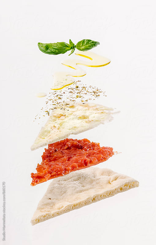 exploded view of a slice of pizza by Juri Pozzi for Stocksy United