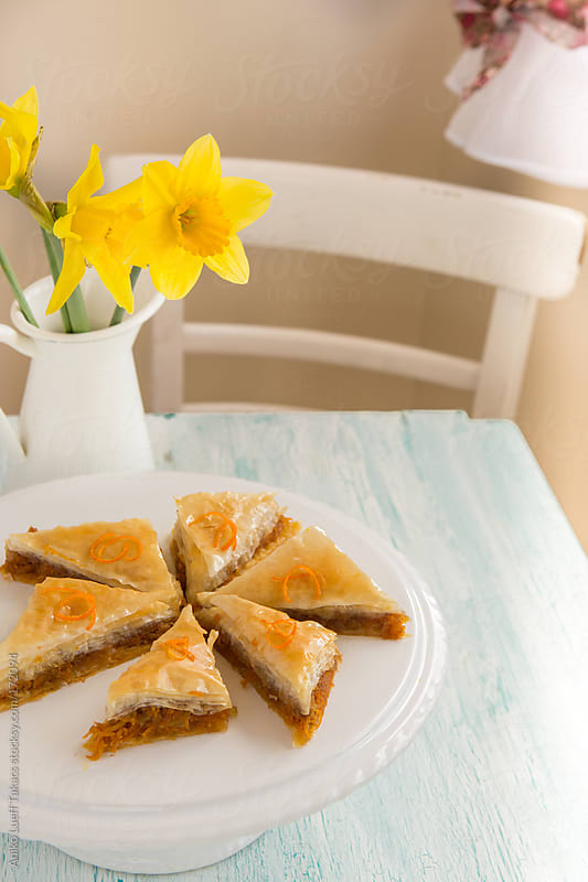 Carrot baklava on cake stand on white table by Aniko Lueff Takacs for Stocksy United