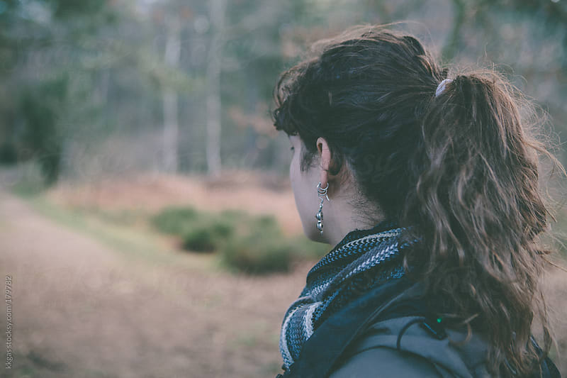 Young woman looking away along a path. by kkgas for Stocksy United