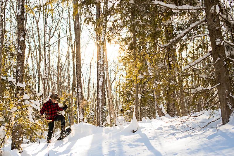 Man In Plaid Jacket Snowshoeing In Northern Winter Woods by JP Danko for Stocksy United