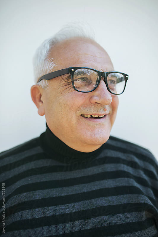 Portrait of an elderly man smiling by Jovana Rikalo for Stocksy United