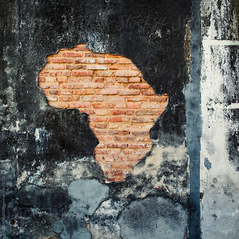 African Continent Outline on Old Wall by VISUALSPECTRUM for Stocksy United