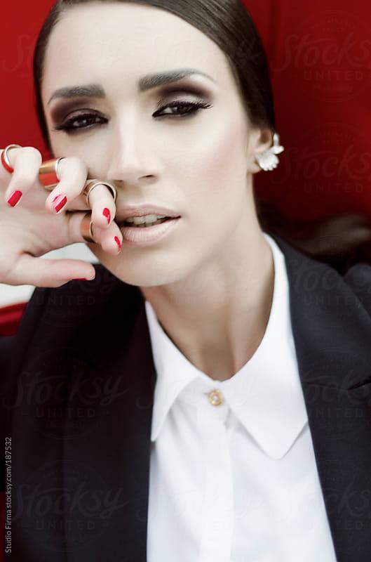 Portrait of a brunette woman by Studio Firma for Stocksy United