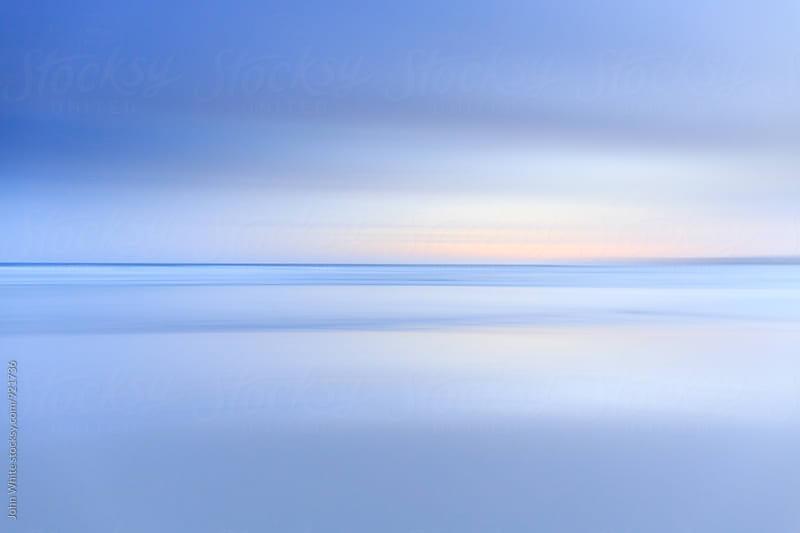 Blur of the ocean. by John White for Stocksy United