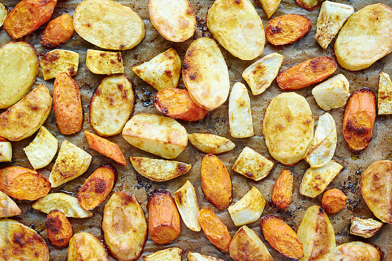 Roasted root vegetables by Harald Walker for Stocksy United