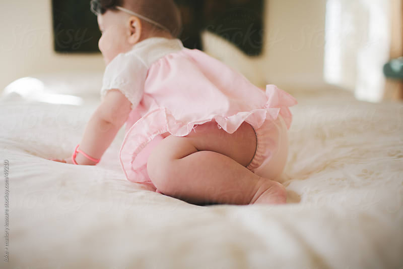 adorable baby girl by luke + mallory leasure for Stocksy United