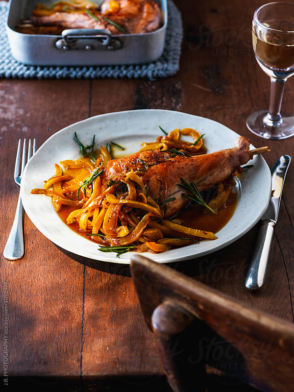 Roasted rabbit with peppers by J.R. PHOTOGRAPHY for Stocksy United