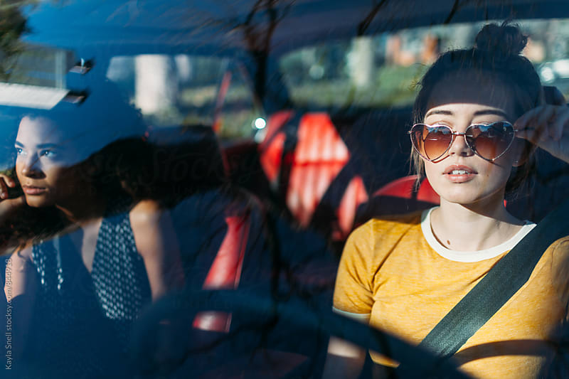 Young woman on a road trip with her friend by Kayla Snell for Stocksy United