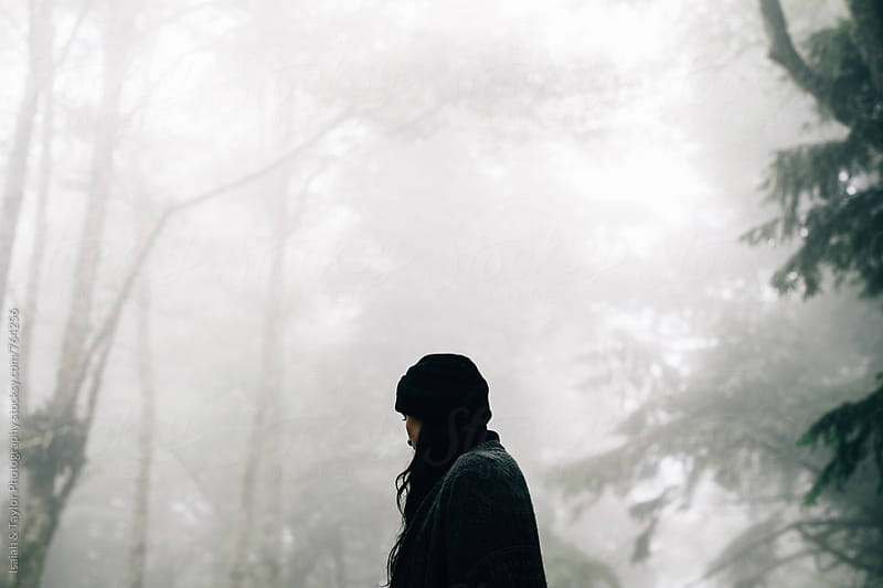 Woman alone in a misty mountain by Isaiah & Taylor Photography for Stocksy United