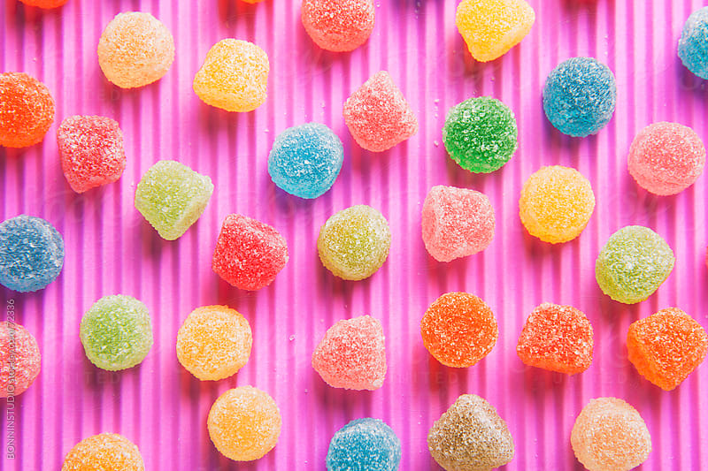 Colourful sugar candy on pink background. by BONNINSTUDIO for Stocksy United
