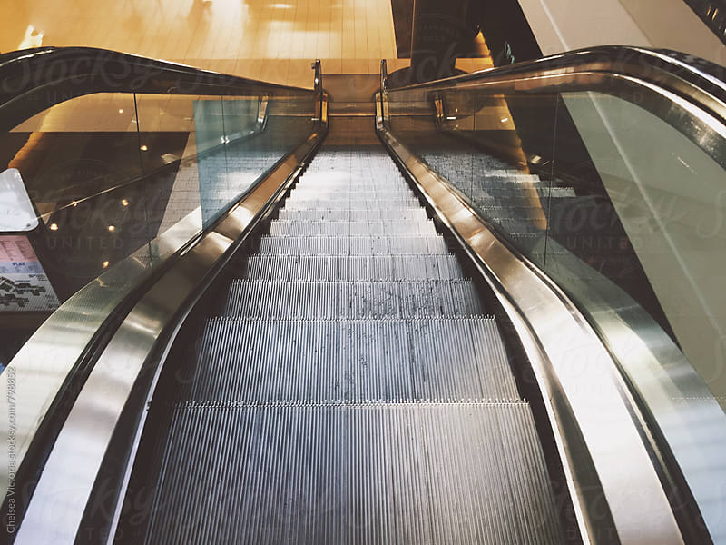 An Escalator in a shopping mall by Chelsea Victoria for Stocksy United