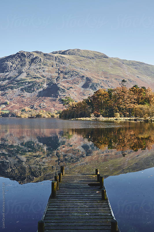 Jetty and autumnal colour. Ullswater, Cumbria, UK. by Liam Grant for Stocksy United