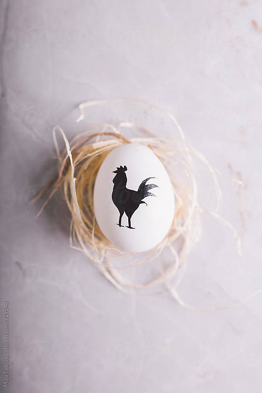 Easter egg against a textured background by Maja Topcagic for Stocksy United