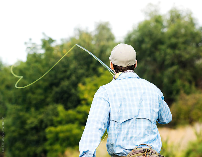 A young man casting his line to fish. by Tana Teel for Stocksy United