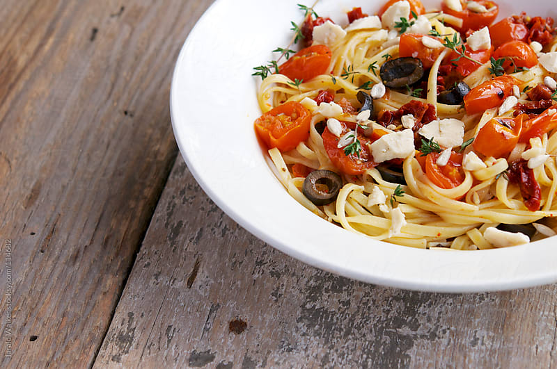 Tagliatelle With Roasted Cherry Tomatoes and Olives by Harald Walker for Stocksy United