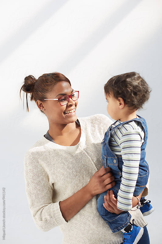 African American mother and child in a happy moment by Miquel Llonch for Stocksy United
