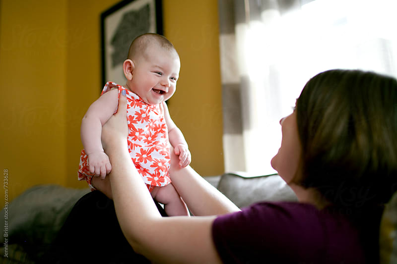 Laughing, happy baby by Jennifer Brister for Stocksy United