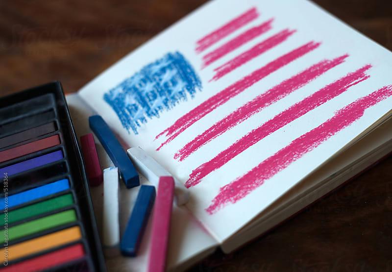 American flag drawn in a journal using chalk pastels by Carolyn Lagattuta for Stocksy United