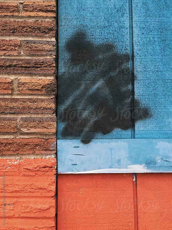 Detail of black graffiti spray paint on building wall by Paul Edmondson for Stocksy United