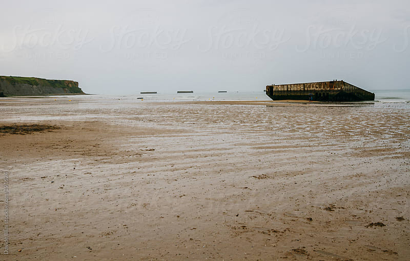 Remains of Mulberry Harbour at Arromanches, Normandy, France by Davide Illini for Stocksy United