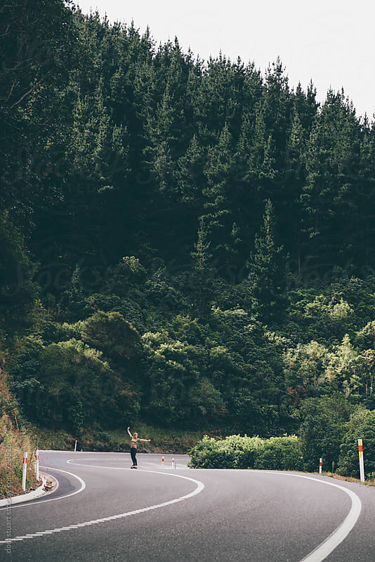 Long boarding Mountain Roads, Nz by dom stuart for Stocksy United