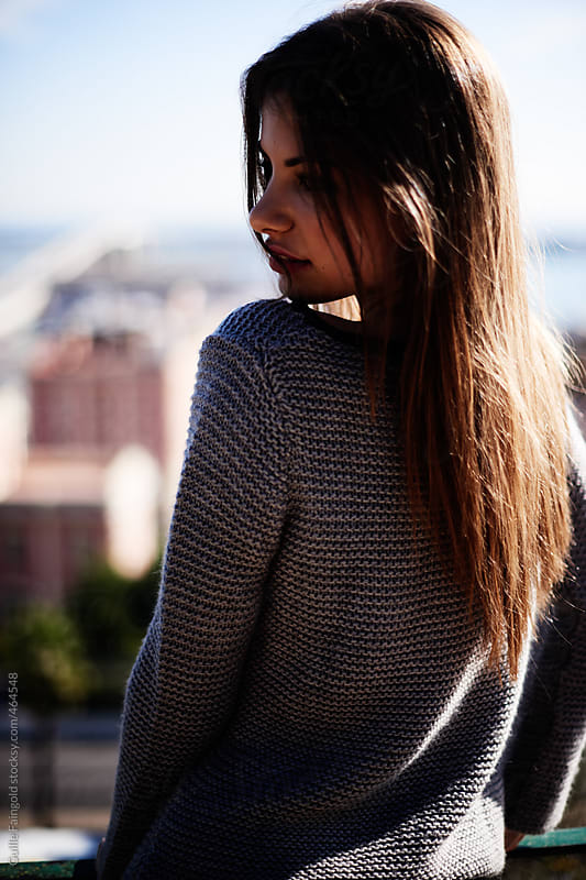 From behind: Stylish female against barcelona´s harbor by Guille Faingold for Stocksy United