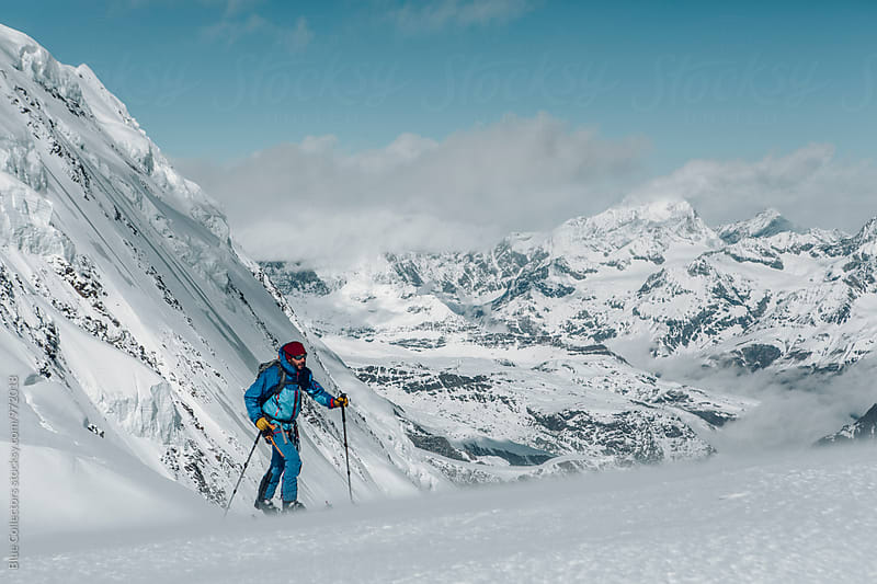 Skier going up with ski touring in the Italian alps by Jordi Rulló for Stocksy United