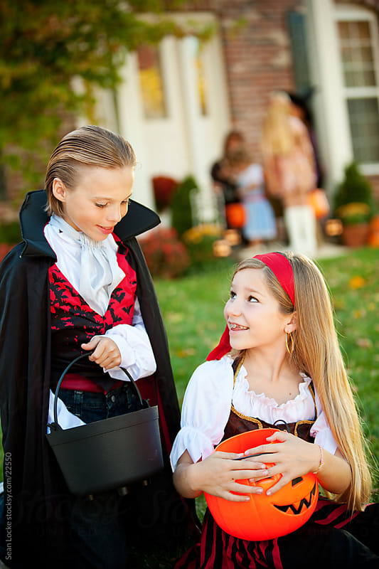 Halloween: Vampire Wants to Trade Candy with Pirate by Sean Locke for Stocksy United
