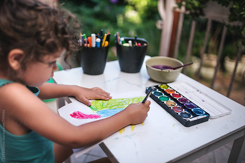 Little girl drawing a turtle with her creative tools around by Lea Csontos for Stocksy United