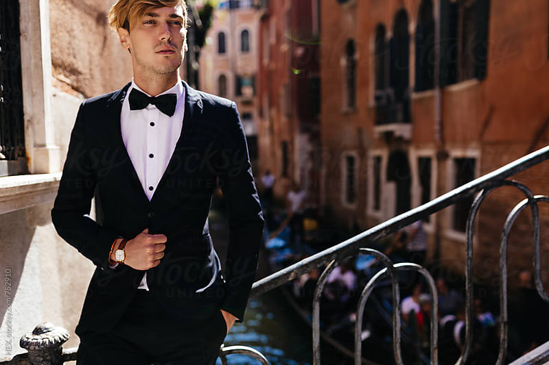 Elegant Young Man Walking in Venice Italy by HEX. for Stocksy United