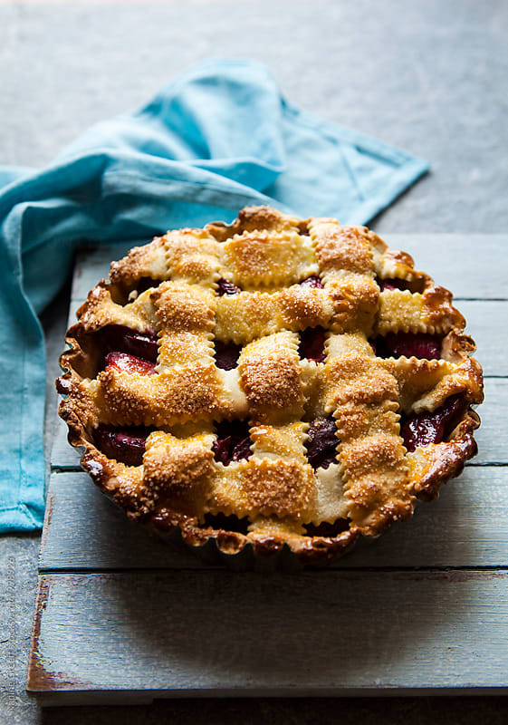 Lattice pastry rhubarb and plum pie by Nadine Greeff for Stocksy United