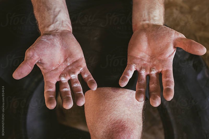 Closeup of hands of man after hard workout. by BONNINSTUDIO for Stocksy United