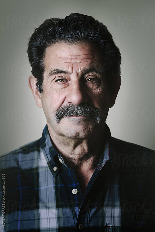 Portrait of a Senior Serious Man by VICTOR TORRES for Stocksy United