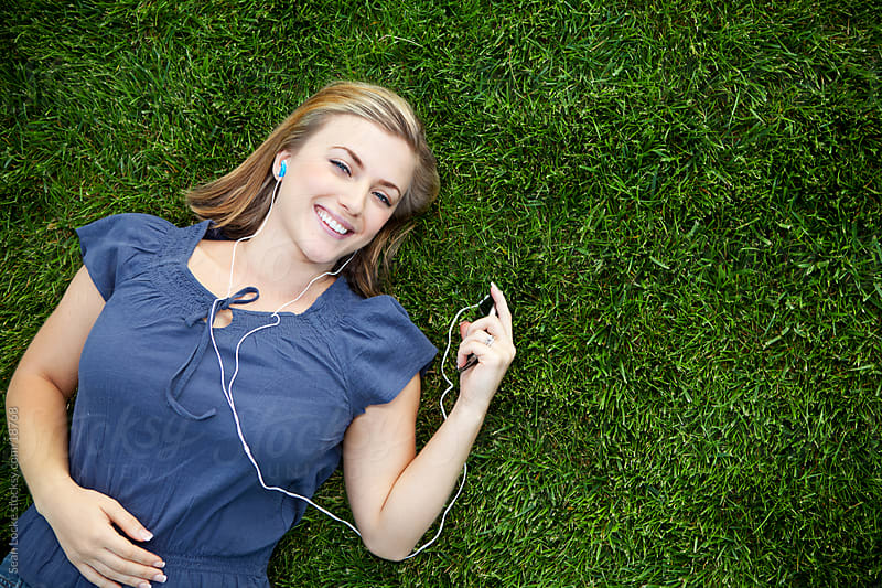 Grass: Woman Having Fun Listening to Music by Sean Locke for Stocksy United