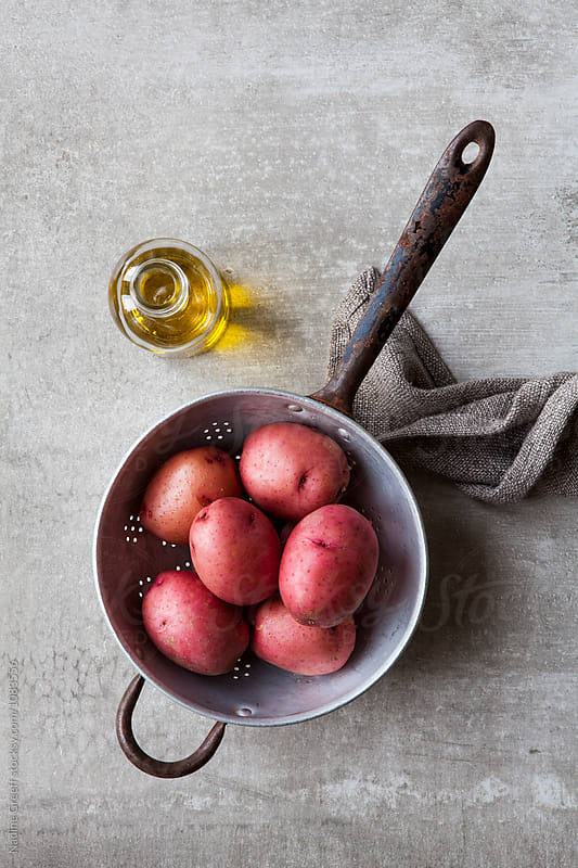 Whole red potatoes by Nadine Greeff for Stocksy United