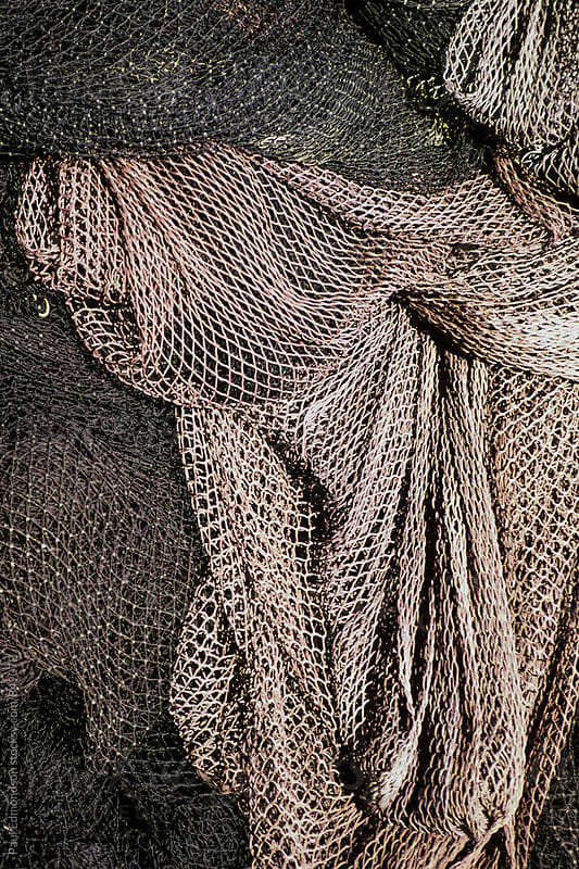 Pile of commercial fishing nets by Paul Edmondson for Stocksy United